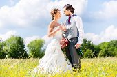 picture of sparkling wine  - Wedding bride and groom toasting with sparkling wine outside on field - JPG