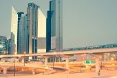 stock photo of emirates  - Skyscraper roads and bridge at the Sheikh Zayed Road in Dubai in the evening - JPG