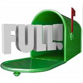 image of junk  - Full Word in 3d letters in a green metal mailbox to illustrate junk messages overflowing an email inbox - JPG
