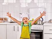 foto of apron  - Child wearing hat and apron cooking at kitchen - JPG