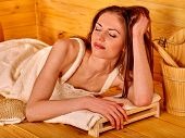 foto of sauna  - Young woman lying  at sauna - JPG