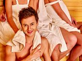 stock photo of sauna  - Group people in towel and hat  relaxing at sauna - JPG