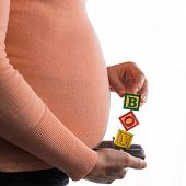 picture of expecting baby  - Mom expecting a baby boy with wooden letter cubes - JPG