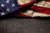 picture of usa flag  - Old and worn American flag for Memorial Day or 4th of July - JPG