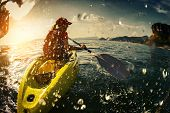 pic of kayak  - Young lady paddling the kayak in the sea with lots of splashes - JPG