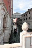 image of gondolier  - Narrow canal with gondoliers in the background - JPG