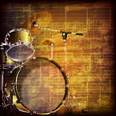 picture of drum-kit  - abstract grunge brown cracked music symbols vintage background with drum kit - JPG