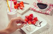 picture of whip-hand  - Fresh strawberries - JPG