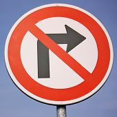 pic of traffic rules  - No right turn traffic sign against blue sky - JPG