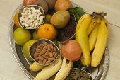 foto of dry fruit  - Top View of Fruits and dry fruits from thread ceremony function - JPG