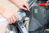 stock photo of wiper  - take the water to Wiper Fluid in tank - JPG