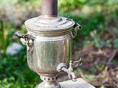 stock photo of boil  - old steel samovar  - JPG