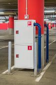 stock photo of fire extinguishers  - Fire extinguisher and fire hose in the mall parking lot  - JPG