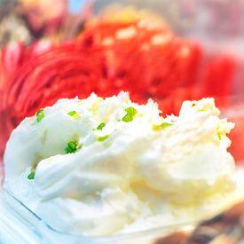 picture of gelato  - Delicious white vanilla and red watermelon ice cream gelato in a box - JPG