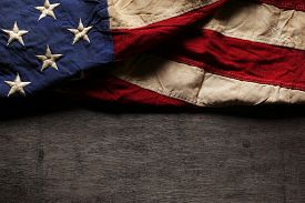 foto of memorial  - Old and worn American flag for Memorial Day or 4th of July - JPG