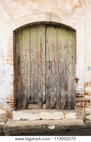 Vintage Green Closed Damaged Door