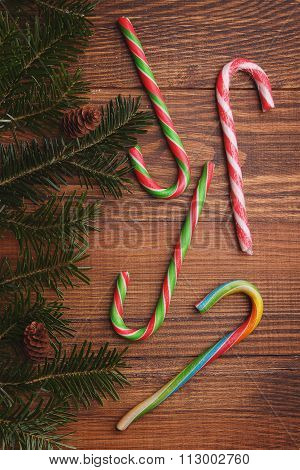 Bright Colored Candy Sticks Against The Backdrop Of The Christmas Tree