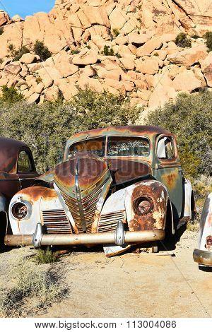 JOSHUA TREE, CALIFORNIA - JANUARY 1, 2016: Junk Plymouth. A rusted old Plymouth at Keys Ranch in Joshua Tree National Park.