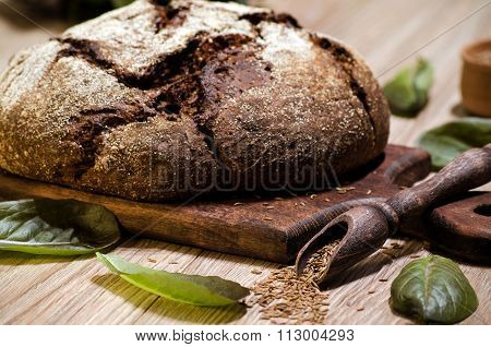 Round Dark Rye Bread With Caraway Seeds And Lettuce