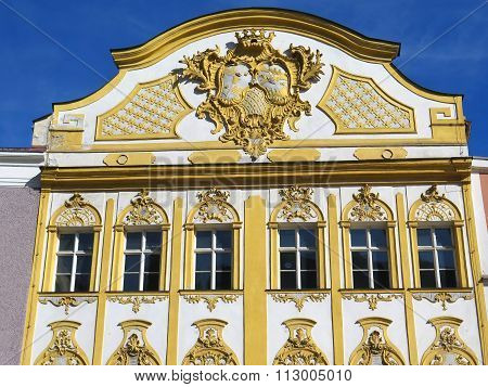 lots of stucco on facade of golden bavarian house, germany