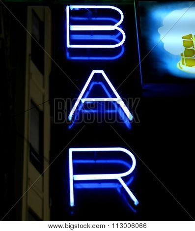 Blue Neon Wine Bar Sign At Night