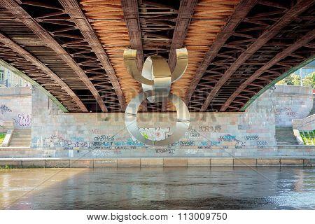 Contemporary Sculpture Under The Bridge In Vilnius