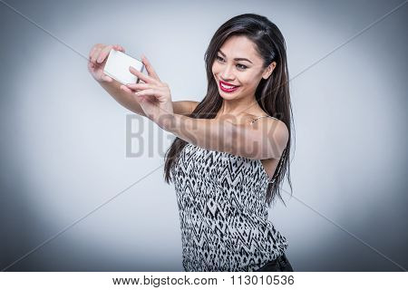 Young Beauty Taking Selfie With Smartphone