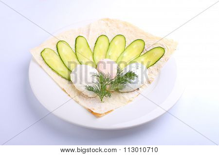 Curd Cheese With Cucumber And Pita Bread On A White Plate