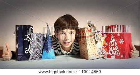 Preteen Handsome Boy With Christmas Presents