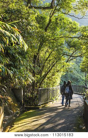 Couple Walks The Romantic Peak Way In Hong Kong, Victoria
