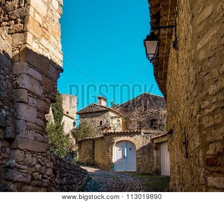 Empty Street Of La Roque-sur-cèze, It Is Very Picturesque Village On A Rocky Peak In Southern France