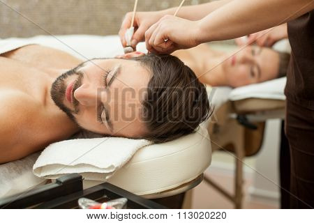 Pretty married couple is relaxing at beauty salon