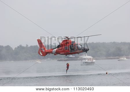 Rescue swimmer in air