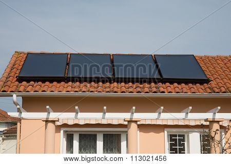 Rooftop Solar Panels On A Modern House