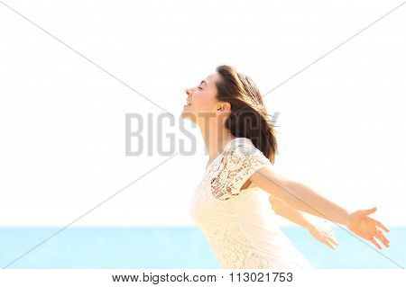 Happy Woman Enjoying The Wind And Breathing Fresh Air
