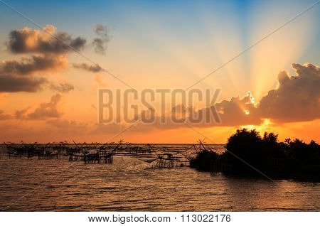 Silhouette of fish lift net in Pak Pra canal in Thailand