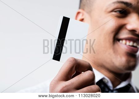 Black Man With Blank Credit Card On Foreground