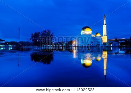 Blue Hour Sunrise At Floating Mosque With Reflection.