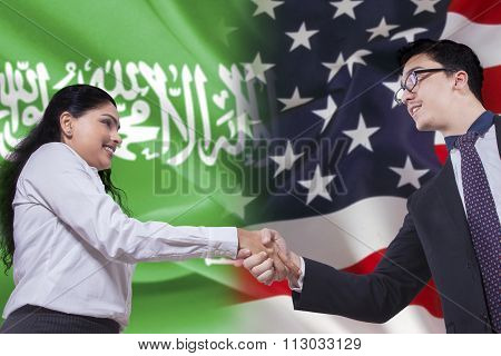 Arabian Woman Shaking Hands With American Person