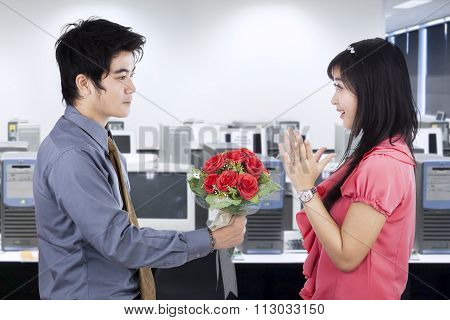 Asian Couple With Flowers