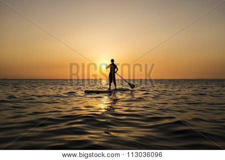 sunset with a surfer