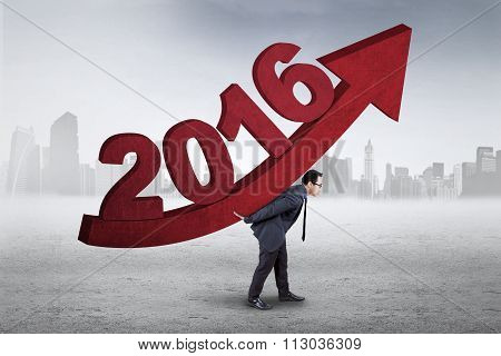 Employee Carrying Upward Arrow And Numbers 2016