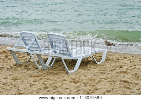 Chaise Longue On A Beach On A Background Of Sea