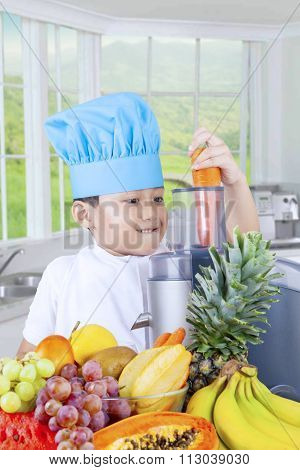 Little Boy Making Fresh Juice