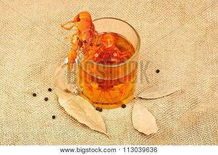 Two Boiled Red Cancers Is Lying On The Glasses Of Fresh Beer