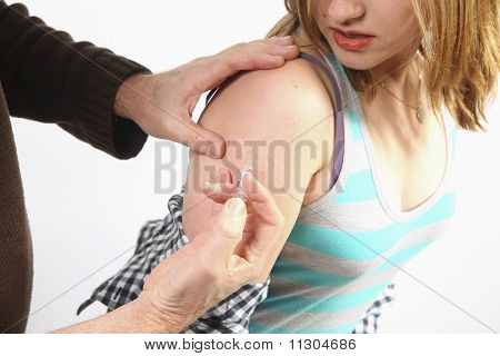 Doctor Giving Injection To A Young Woman