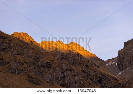 Warm Light At Sunset On Rocky Mountain Peaks