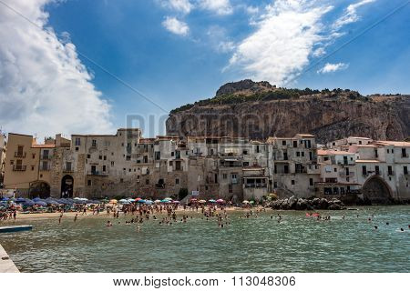 CEFALU, ITALY - AUGUST 04 2015: Cefalu's beach