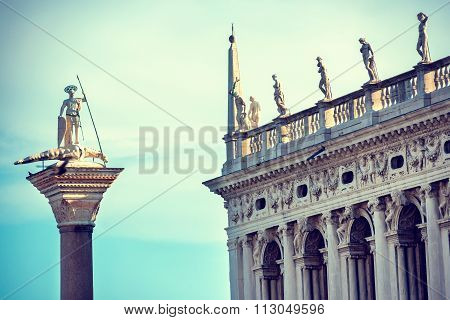The Statue Of St. Theodore And Doge's Palace In Venice