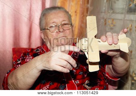 Elderly Woman And Airplane